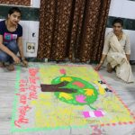 two girls making rangoli