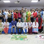 A group of people at Rangoli Making Competition