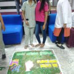 two girls standing next to a Rangoli