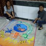 Two Girls are making rangoli